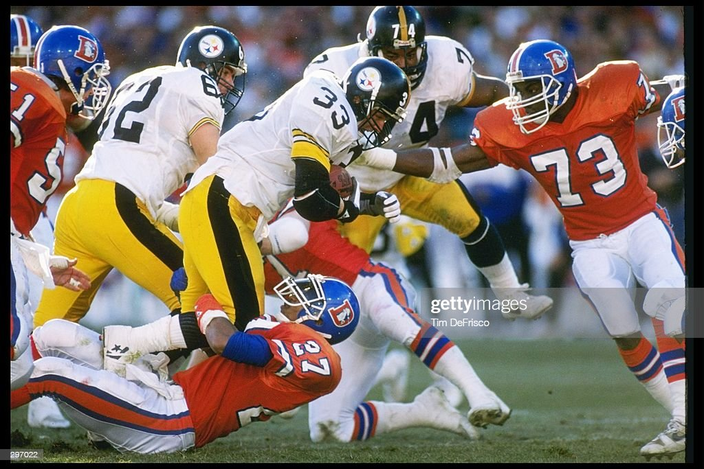 Running back Merril Hoge of the Pittsburgh Steelers moves the ball during a playoff game against the Denver Broncos at Mile High Stadium in Denver, Colorado. The Broncos won the game, 24-23. Mandatory Credit: Tim DeFrisco /Allsport