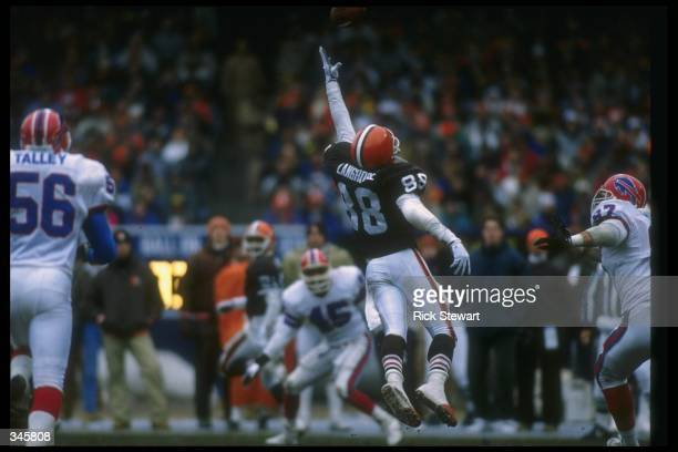 Wide receiver Reggie Langhorne of the Cleveland Browns goes up for the ball during a playoff game against the Buffalo Bills at Rich Stadium in...