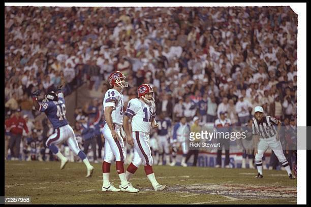 Kicker Scott Norwood of the Buffalo Bills looks dejected after missing a 47yard field goal wide right as time expired that would have won the game...
