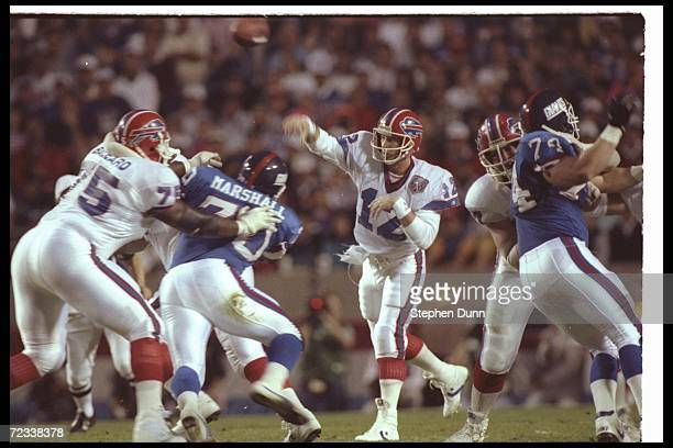 Quarterback Jim Kelly of the Buffalo Bills throws the ball against the New York Giants during Super Bowl XXV at Tampa Stadium in Tampa Florida The...