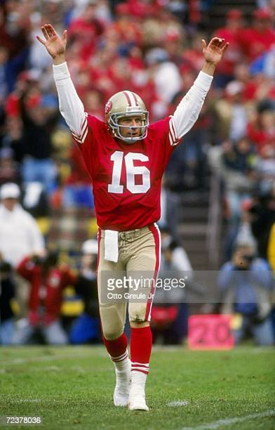 Quarterback Joe Montana of the San Francisco 49ers raises his hands in celebration after throwing a touch down pass in the 49ers 2810 victory over...