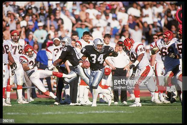 Running back Bo Jackson of the Los Angeles Raiders moves the ball during a playoff game against the Cincinnati Bengals at the Los Angeles Memorial...