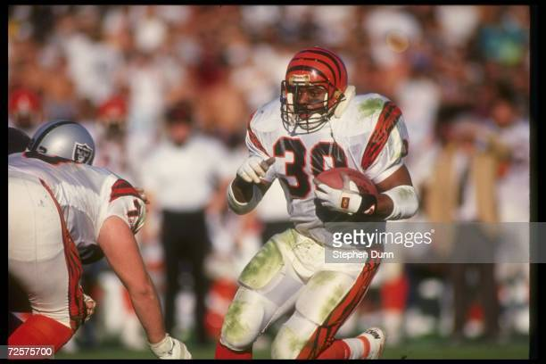 Running back Ickey Woods of the Cincinnati Bengals runs with the ball during a playoff game against the Los Angeles Raiders at the Coliseum in Los...