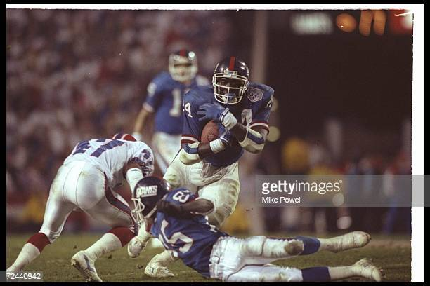 Running back Ottis Anderson of the New York Giants moves the ball against the Buffalo Bills during Super Bowl XXV at Tampa Stadium in Tampa Florida...
