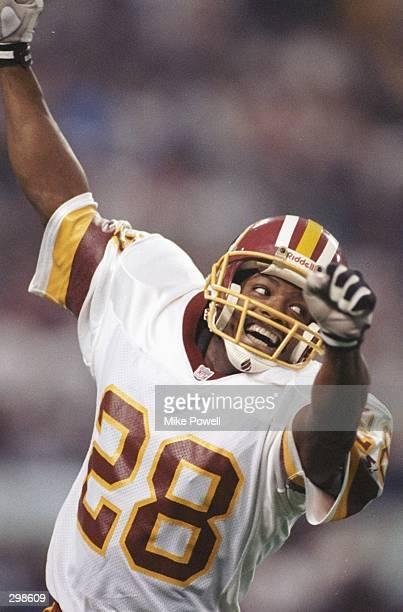 Defensive back Darrell Green of the Washington Redskins celebrates during Super Bowl XXVI against the Buffalo Bills at the Hubert H. Humphrey...