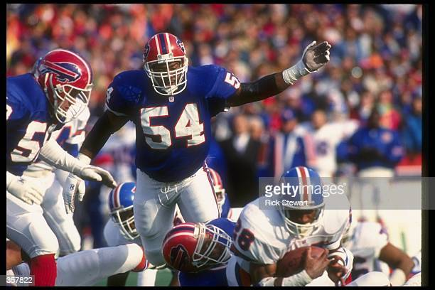 Linebacker Carlton Bailey of the Buffalo Bills works against the Denver Broncos during a playoff game at Rich Stadium in Orchard Park, New York. The...