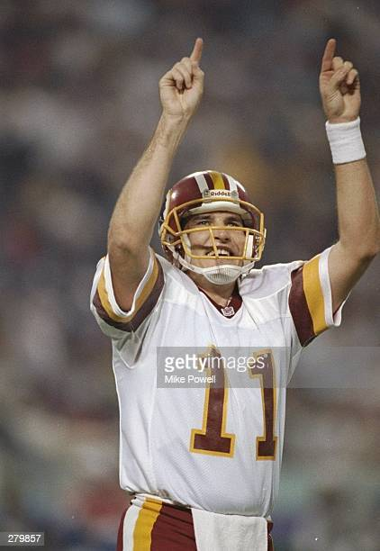 Quarterback Mark Rypien of the Washington Redskins celebrates during Super Bowl XXVI against the Buffalo Bills at the Hubert H Humphrey Metrodome in...