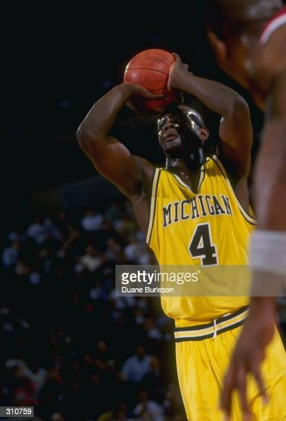 Chris Webber of the Michigan Wolverines moves the ball during a game against the Ohio State Buckeyes Mandatory Credit Duane Burleson /Allsport