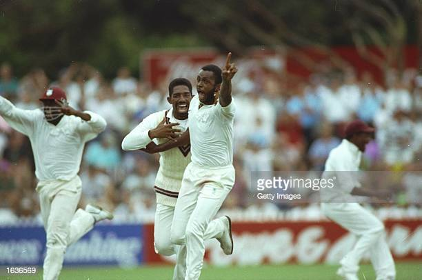 Courtney Walsh of the West Indies celebrates their historic victory during the Fourth Test match against Australia in at the Adelaide Oval in...