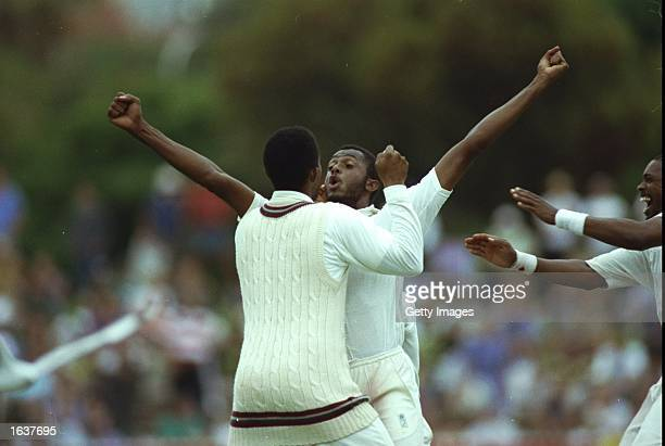 Courtney Walsh of the West Indies raises his arms in celebration after their victory in the Fourth Test match against Australia at the Adelaide Oval...