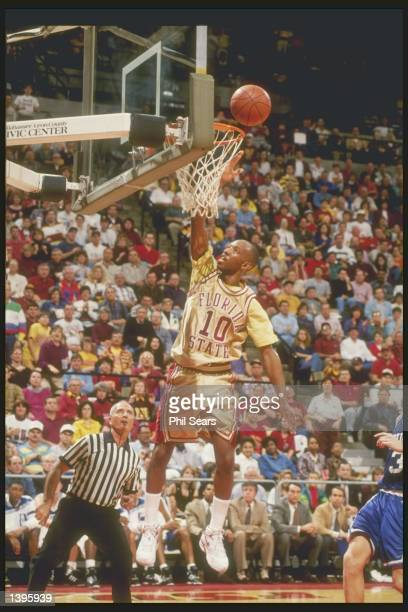 Guard Sam Cassell of the Florida State Seminoles lays up the ball during a game against the Duke Blue Devils at the Leon County Civic Center in...