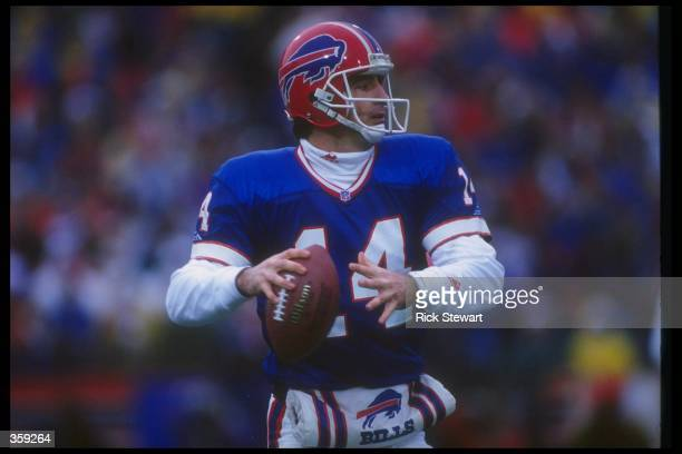 Quarterback Frank Reich of the Buffalo Bills looks to pass the ball during a playoff game against the Houston Oilers at Rich Stadium in Orchard Park...