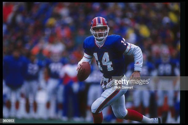 Quarterback Frank Reich of the Buffalo Bills looks to throw the ball during a playoff game against the Houston Oilers at Rich Stadium in Orchard Park...
