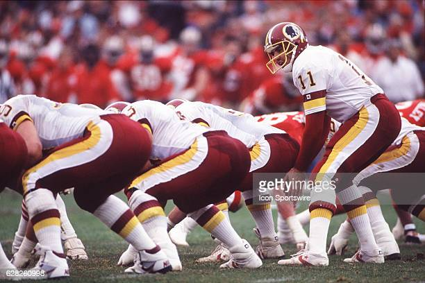 Quarterback Mark Rypien of the Washington Redskins calls the snap count from under center during the Redskins 2013 loss to the San Francisco 49ers in...