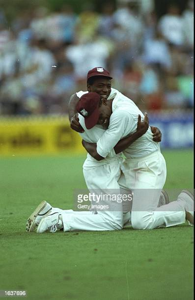West Indies players celebrate after their victory in the Fourth Test against Australia at the Adelaide Oval in Australia. The West Indies won the...