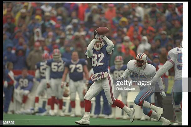 Wide receiver Don Beebe of the Buffalo Bills catches the ball during a playoff game against the Houston Oilers at Rich Stadium in Orchard Park New...