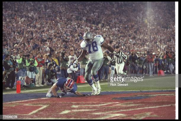 Wide receiver Don Beebe of the Buffalo Bills forces a fumble on defensive tackle Leon Lett of the Dallas Cowboys during Super Bowl XXVII at the Rose...