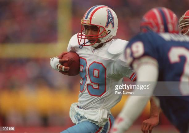 Wide receiver Webster Slaughter of the Houston Oilers carries the football after making a catch during the Oilers 4138 loss to the Buffalo Bills at...