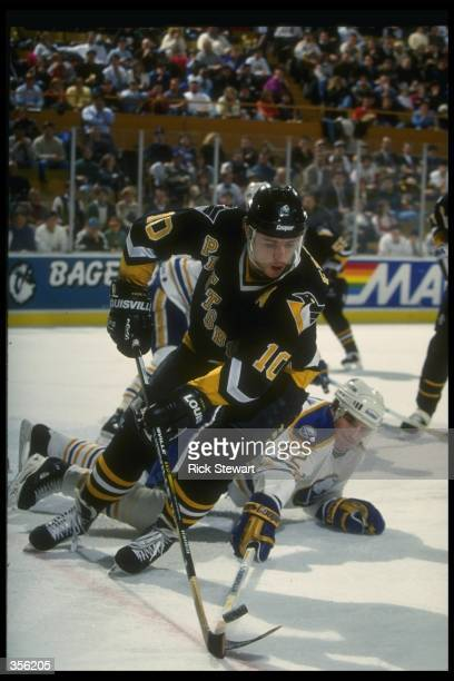 Center Ron Francis of the Pittsburgh Penguins moves down the ice during a game against the Buffalo Sabres at Memorial Auditorium in Buffalo, New York.