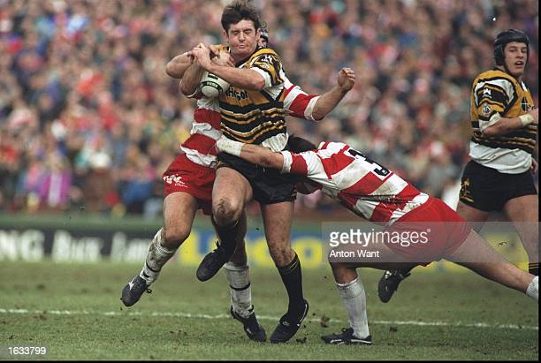 Grant Anderson of Castleford looks for a way through the Wigan defence during the Regal Trophy final Castleford won the match 332 Mandatory Credit...