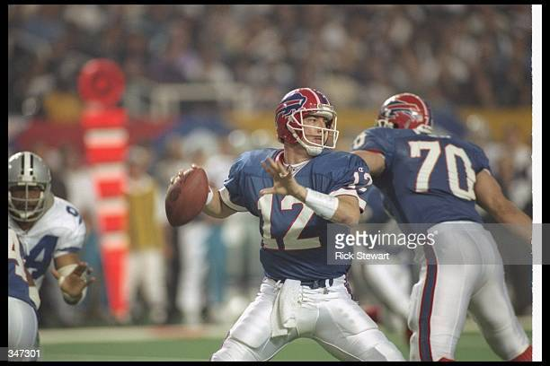 Quarterback Jim Kelly of the Buffalo Bills looks to pass the ball during Super Bowl XXVIII against the Dallas Cowboys at the Georgia Dome in Atlanta...