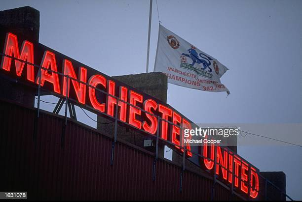 Manchester united flag getty images the flag flys at half mast as a tribute to sir matt busby at old trafford saudi fans hold a manchester united flag voltagebd Image collections