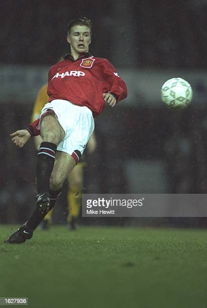 David Beckham of Manchester United in action during the FA Cup fourth round match against Wrexham at Old Trafford in Manchester England Manchester...