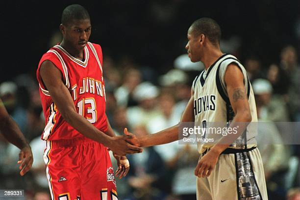 FELIPE LOPEZ OF THE ST JOHN''S REDMEN SHAKES HANDS WITH GEORGETOWN''S