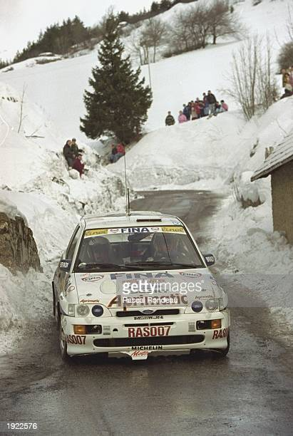 Francois Delecour and Catherine Francois of France in action in their Ford Escort Cosworth during the Monte Carlo Rally in Monaco Delecour and...