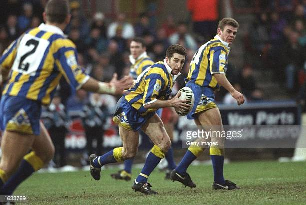 Jonathan Davies of Warrington charges forward during the Regal Trophy final against Wigan at the McAlpine Stadium in Huddersfield, England. Wigan won...