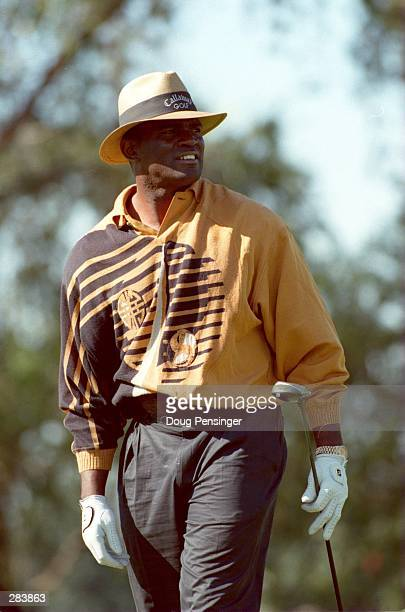 LAWRENCE TAYLOR WATCHES A DRIVE DURING HIS ROUND AT THE TENTH ANNUAL NFL CHARITY GOLF CLASSIC AT DORAL COUNTRY CLUB IN DADE, FLORIDA.