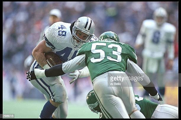 Linebacker Bill Romanowski of the Philadelphia Eagles looks to tackle Dallas Cowboys running back Daryl Johnston during a playoff game at Texas...