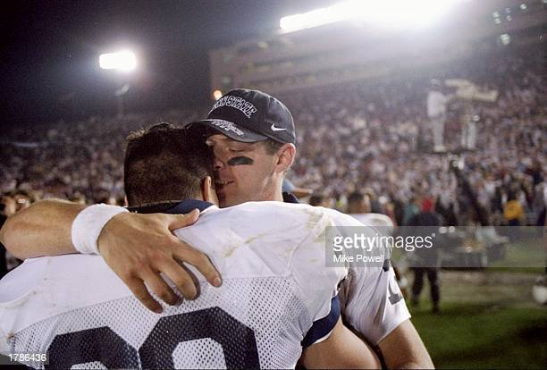 Quarterback Kerry Collins and fullback Jon Witman of the Penn State Nittany Lions hug each other after the Rose Bowl against the Oregon Ducks at the...