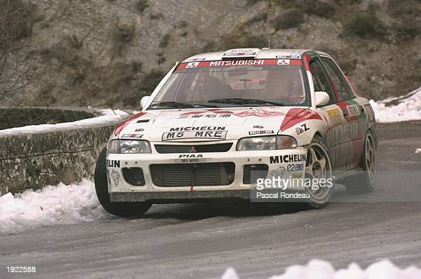 Tommi Makinen and Seppo Harjane of Finland in action in their Mitsubishi Lancer during the Monte Carlo Rally in Monaco. Makinen and Harjane finished...