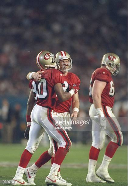 9837bcfe8bd Super Bowl XXIX. Wide receiver Jerry Rice and quarterback Steve Young of  the San Francisco 49ers celebrate a l5