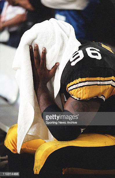 Brentson Buckner of the Pittsburgh Steelers sits dejected after the Steelers loss to the Dallas Cowboys in Super Bowl XXX at Sun Devil Stadium in...