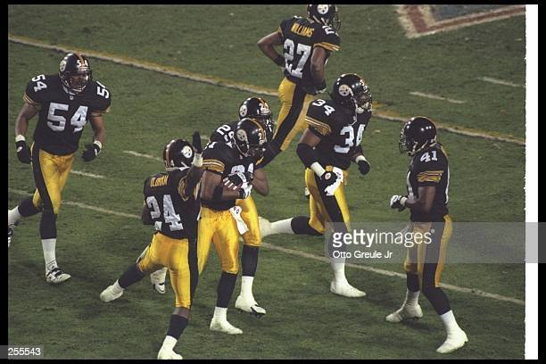 Cornerback Deon Figures of the Pittsburgh Steelers celebrates with teammates after recovering an onside kick against the Dallas Cowboys at Super Bowl...