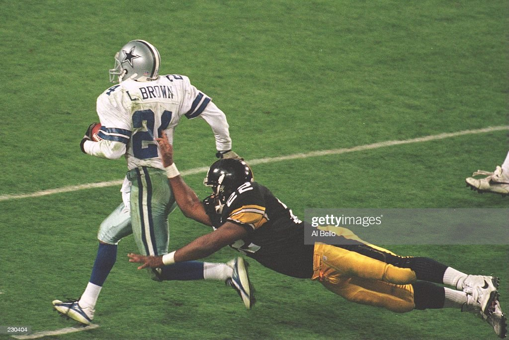 Cornerback Larry Brown #24 of the Dallas Cowboys is knocked out of bounds by running back John L. Williams #22 of the Pittsburgh Steelers during the 4th quarter of the Cowboys game versus the Pittsburgh Steelers in Super Bowl XXX at Sun Devi