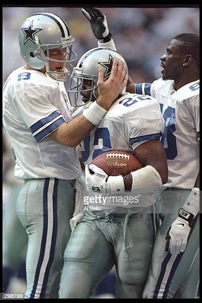Dallas Cowboys quarterback Troy Aikman running back Emmitt Smith and wide receiver Michael Irvin celebrate during a playoff game against the Green...