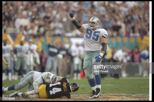 Defensive lineman Charles Haley of the Dallas Cowboys celebrates as teammate Chad Hennings sacks Pittsburgh Steelers quarterback Neil O''Donnell...