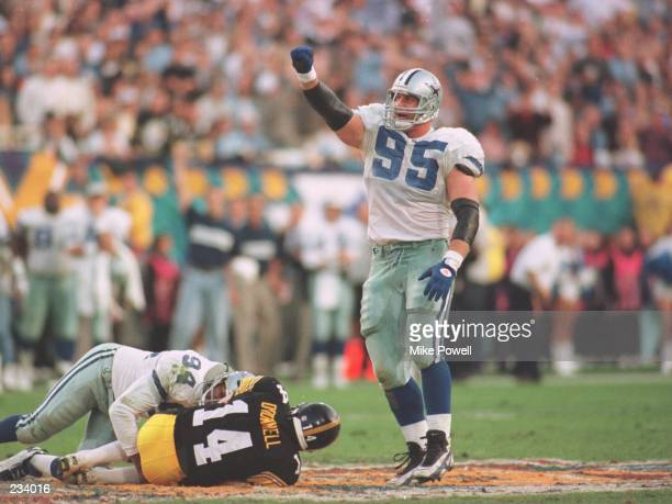 Defensive tackle Chad Hennings celebrates a 9yard sack on quarterback Neil O'Donnell of the Pittsburgh Steelers during the Cowboys game versus the...