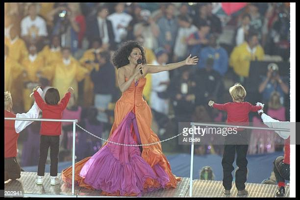 Diana Ross sings during the halftime show for Super Bowl XXX between the Dallas Cowboys and the Pittsburgh Steelers at Sun Devil Stadium in Tempe...
