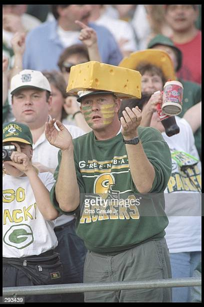 Fans watch a playoff game between the Green Bay Packers and the San Francisco 49ers at 3Com Park in San Francisco, California. The Packers won the...