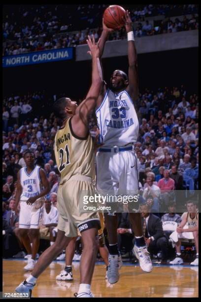 Forward Antawn Jamison of the University of North Carolina Tar Heels attempts a jumper over the head of center Tim Duncan of the Wake Forest Demon...