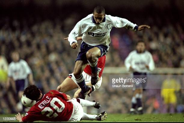 Gary Neville of Manchester United slides in to tackle Chris Armstrong of Tottenham Hotspur during the FA Carling Premiership match played at White...
