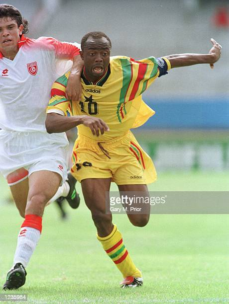 Ghana's Abedi Pele chases the ball during Ghana's 21 victory today at Port Elizabeth in the First round of the African Cup of Nations Mandatory...