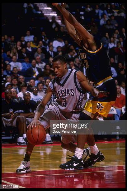 Guard Allen Iverson of the Georgetown Hoyas drives inside around a defending West Virginia Mountaineer at the USAir Arena in Washington DC Georgetown...