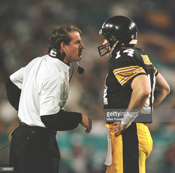 Head Coach Bill Cowher and quarterback Neil O'Donnell of the Pittsburgh Steelers share a few words during the Steelers game versus the Dallas Cowboys...