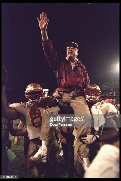 Head coach Bobby Bowden of the Florida State Seminoles is carried triumphantly off the field by nose guard Andre Wadsworth and tackle Orpheus Roy...
