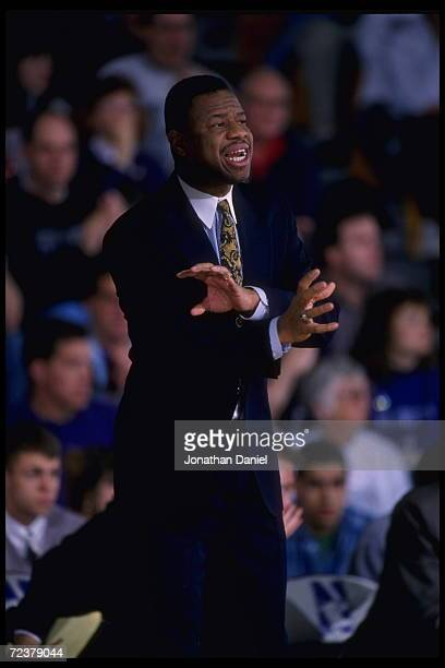Head coach Ricky Byrdsong of the Northwestern Wildcats calls instructions to his team as they play the Wisconsin Badgers at WelshRyan Arena in...
